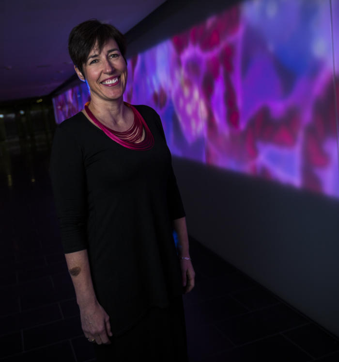 Associate Professor Clara Gaff says our genomic information is the equivalent of 1000 copies of the novel. War and Peace. Picture: Chris Hopkins