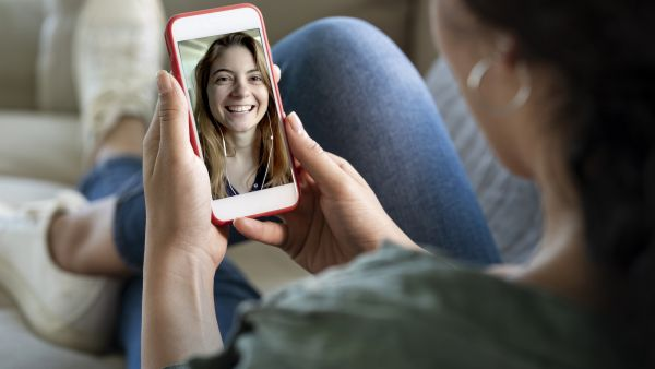 Person using smart phone for video call