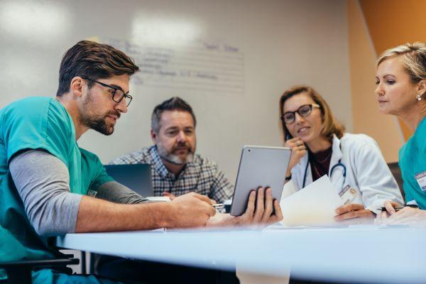 Clinical care team discuss a patient case